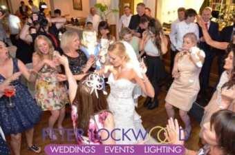 bride-and-the-girls-enjoying-the-wedding-in-the-Bridge-Hotel-Prestbury