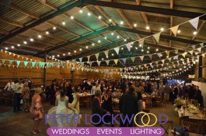 wedding festoon lighting in a barn