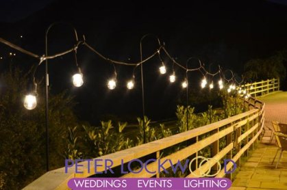 festoon lighting hire on a fence