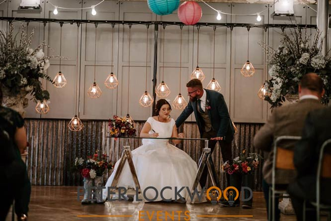 edison bulb wedding backdrop with copper shades