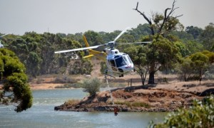 A helicopter helps firefighting efforts at Walyunga National Park. Picture: David Ridgway. Taken from www.thewest.com.au
