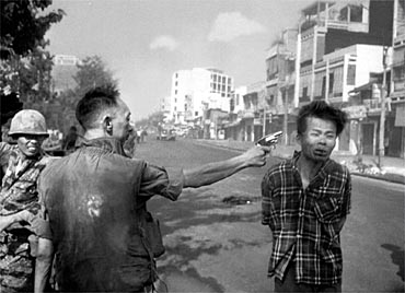 RETRANSMISSION TO RESIZE FILE--FILE--South Vietnamese National Police Chief Brig Gen. Nguyen Ngoc Loan executes a Viet Cong prisoner with a single pistol shot in the head in Saigon Feb. 1, 1968. Nguyen died Wednesday, July 15, 1998 at his home in Burke, a suburb of Washington, D.C., after a battle with cancer, said his daughter, Nguyen Anh. He was 67. This photo of Nguyen aiming a pistol point-blank at the grimacing prisoner's head became a memorable image of the Vietnam War. The photograph, by Eddie Adams, won a Pulitzer prize for The Associated Press. (AP Photo/Eddie Adams)