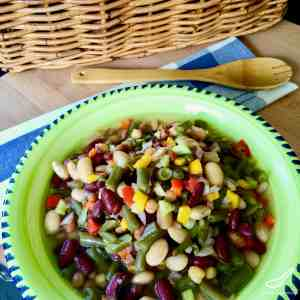 An Easy 7 Bean Salad recipe perfect for large potlucks, church events, bbq's or summertime gatherings. Looks and tastes amazing!