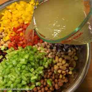 An Easy 7 Bean Salad Recipe perfect for summertime picnics and potlucks. Looks and tastes amazing!