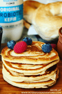 Oladi - Russian pancakes made with Kefir, topped with fresh berries, blueberry jam and sour cream. A healthy and tasty way to make pancakes. Kefir Pancakes (Оладьи)