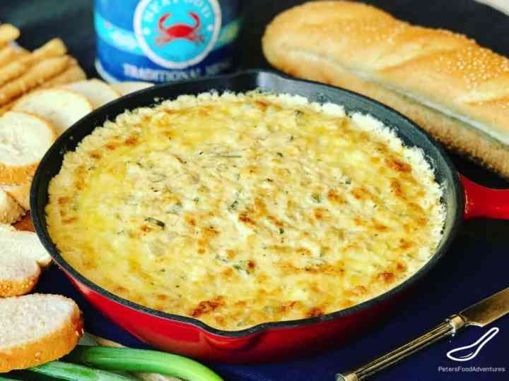 Hot Baked Crab and Artichoke Dip, Super Cheesy! Easy to make, leaving you wanting more. The perfect appetizer for party food!