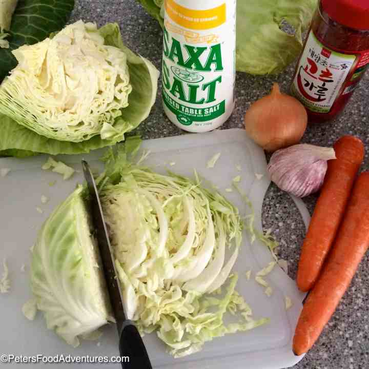 slicing cabbage for spicy sauerkraut on a cutting board