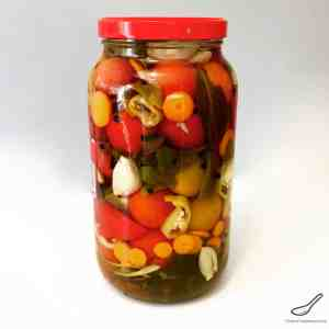 Enjoy your fresh, garden tomatoes by preserving them Russian-style. Pickled with garlic and herbs, these canned tomatoes are a staple year round - Russian Pickled Tomatoes (солёные помидоры)