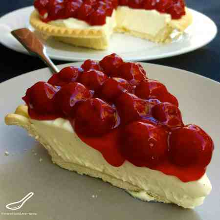 Is it a Cherry Pie or Cherry Cheesecake? It's Both! Incredibly easy to make and a crowd pleaser. No Bake Vanilla Bean Cherry Cheesecake Cherry Pie!