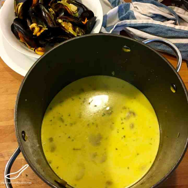 White wine sauce for mussels with turmeric in a pot