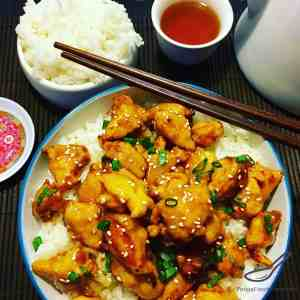 Who needs takeout? Step by step recipe for a sweet and sticky family dinner favourite. Boneless Chicken, honey, garlic, soy and sesame, served over rice - Easy Honey Sesame Chicken
