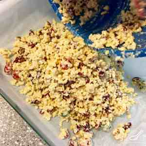 An Australian Christmas favourite, easy to make, love by kids and grown ups. Perfect for the holidays! Made with coconut oil, dried cranberries, Rice Krispies and white chocolate - White Christmas Slice Recipe