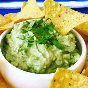 My favorite easy Guacamole recipe, so quick to make with authentic flavours like Tabasco Chipotle, Cilantro and Lime Juice. Perfect for Super Bowl, or just with Nachos, Tacos or as a dip for Corn Chips - Easy Chipotle Guacamole Recipe