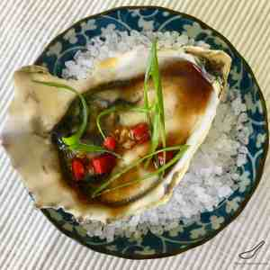 Freshly shucked oysters drizzled with an Asian vinaigrette, with fresh chili pepper and grated ginger. You'll definitely fall in love with my Asian Style Oysters Recipe