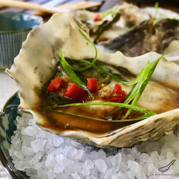 Freshly shucked oysters drizzled with an Asian vinaigrette, with fresh chili pepper and grated ginger - Asian Fresh Oysters Recipe