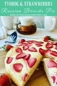 A baked brioche style sweet bread generously smothered with sweet Tvorog cheese, Farmer's Cheese or Quark and baked with fresh strawberries. Similar to a Vatrushka (Ватрушка) or Shaneshki (Шанежки). Part Russian cheesecake, part Russian brioche bun (сдобное sdobnoe) Russian Sweet Cheese Pastry with Strawberries (Сдобный творожный пирог)