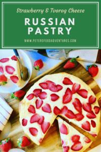 This giant Vatrushka Russian Pastry with Strawberries and Farmer's Cheese (Сдобный творожный пирог) is a mouthful to pronounce, but so delicious! A baked brioche style yeast bun generously smothered with sweet Tvorog, Farmer's Cheese or Quark and baked with fresh strawberries.
