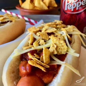 Super Easy Tex-Mex Chili Hot Dogs with Stagg chili, cheese and crushed Doritos, a new family favorite! Hot Dog Toppings Recipes