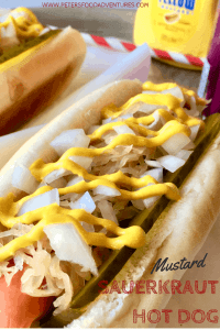 Sauerkraut Dog with sliced dill pickles, onion and tasty mustard
