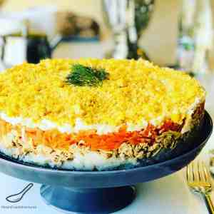 You have to try this Mimoza Salad (Мимоза)! A delicious Russian layered salad popular during celebrations and holidays. A hearty salad with Tuna, Potatoes, Carrots, Eggs and of course, lots of Mayo. Who needs regular potato salad when you can have Mimoza!