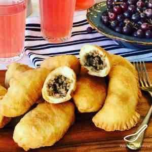 Beef Piroshki are a fried Russian hand pie, or meat pie. Simple, like an empanada. A favorite Russian snack stuffed with beef and onion. Piroshki Recipe (Жареные пирожки)