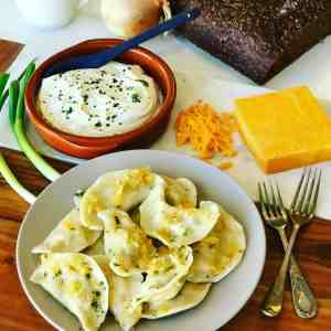 This Potato Cheddar Pierogi Recipe is a Canadian and American Classic dish with roots in Poland and Eastern Europe. Boiled or fried, served with sour cream, Potato and Cheddar dumplings, the perfect comfort food!