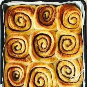 unfrosted tray of cinnamon bun swirls
