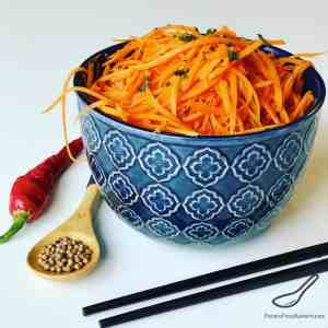 A delicious Carrot Salad recipe from Russia called morkovcha, with roots of Korean immigrants. Thinly julienned carrots with garlic, vinegar, spices and onions in hot oil. A family favorite. (Морковь по-корейски)