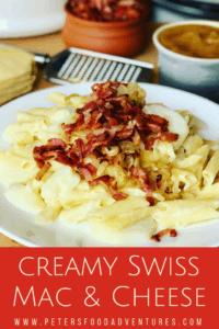 Alplermagronen - Swiss Mac and Cheese is the ultimate Alpine comfort food. Macaroni, Swiss cheese, potatoes, caramelized onions, and bacon, served with apple sauce. Your family will love this dinner recipe! Swiss Mac and Cheese with Potatoes (Älplermagronen)
