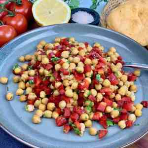 A delicious Chickpea Salad, roasted for extra flavor. A healthy side dish for your next dinner or picnic, made with red pepper, cilantro and garlic. An easy make ahead salad that's vegan and gluten free.