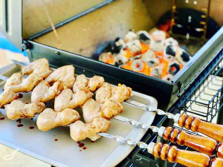Grilled Chicken Wings are a summer bbq favorite. Make it on skewers on a grill over hot coals. Asian Marinade with Garlic Soy that flavors through to the bone.