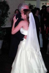 "Bride/Father dance: ""All the Words in the World"" by Neil Sedaka."