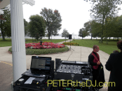 Outdoor DJ setup under the porch awning (rain was expected). Note the speaker out as far as the cable would allow, and the ceremony was waaaaaay down at the end of that path. But the speaker carried well across the lawn!
