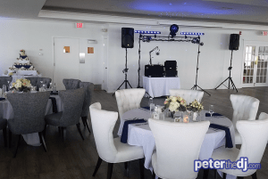 Indoor wedding reception DJ setup for Chris and Ashley's wedding at Lake Shore Yacht & Country Club, Cicero, NY.