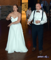 Bride and groom dancing at Emily and Nick's wedding at Tailwater Lodge, Altmar, NY. Photo by DJ Peter Naughton. October 2018