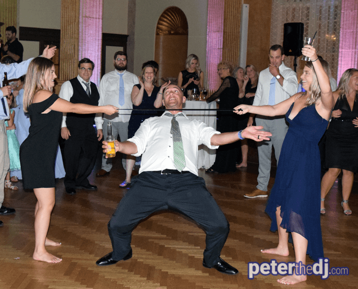 An impromptu limbo line at Erin and Tim's 2019 wedding reception in at the Marriott Syracuse Downtown - Photo by DJ Peter Naughton peterthedj.com