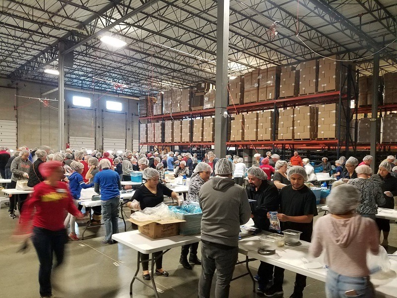 The 2-day pack event took place in the Pet Factory facility and over 2,200 community volunteers packed 544,320 meals.