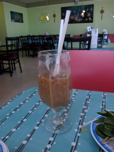 Cà phê sữa đá, iced milk coffee, is made with sweetened condensed milk. Vietnam is famous for its coffee and has a long-standing cafe culture.