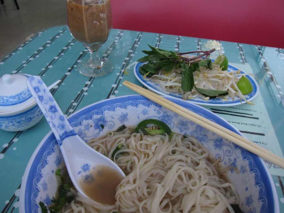 Phở bò (Beef pho) served with garnishes like bean sprouts, Thai basil, chilis and lime. No, I couldn't wait to eat until I took the picture.