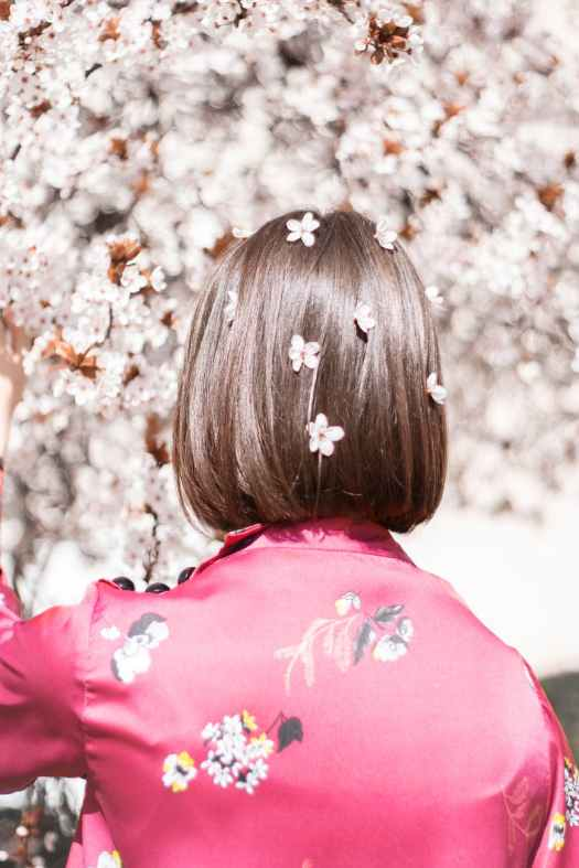 woman with flowers in hair from blooming tree