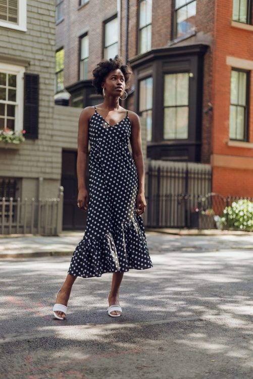 Posing in the Street in a polka dot dress