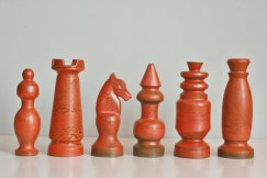 Red pieces from a chess set made by Nico Bongers during an internship at Bay Keramik in the mid 1960s, West Germany