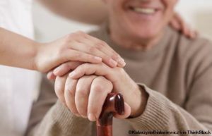 Close up of helpful carer hand and happy old man