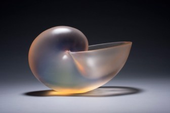 "Nautilus Opalescent Peach ,Medium: Glass Size: 10.5"" x 16"" x 9"" Artist: George Bucquet"