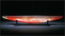 Red Long Boat, Medium: Sand Moulded Glass Size: Artist: Steven Maslach