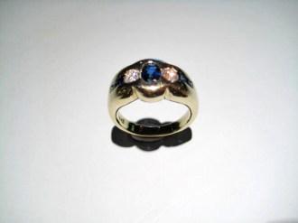 18K Yellow Gold Ring with .42c Diamond and .78c Sapphire Artist: Steve Samuel Catalog: 602-80-1