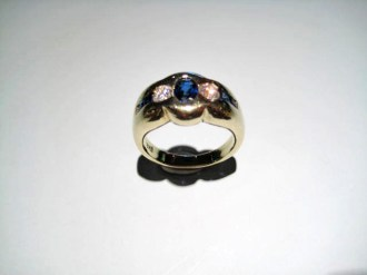 18K Yellow Gold Ring with .42c Diamond and .78c Sapphire Artist: Steve Samuel Catalog: 602-80-1