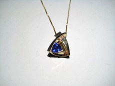 14K Gold Pendant and Chain with .10c Tanzanite and .65c Diamond Artist: Frank Catalog: 897-91-4