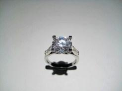 Platinum Ring with .28c Diamond and C.Z. Artist: Varna Catalog: 602-62-3