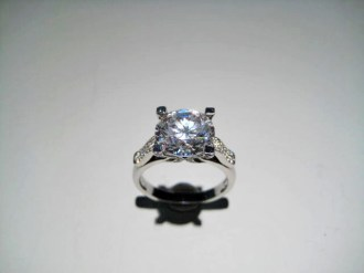 Platinum Ring with .28c Diamond and C.Z. Artist: Varna Catalog: 602-62-3